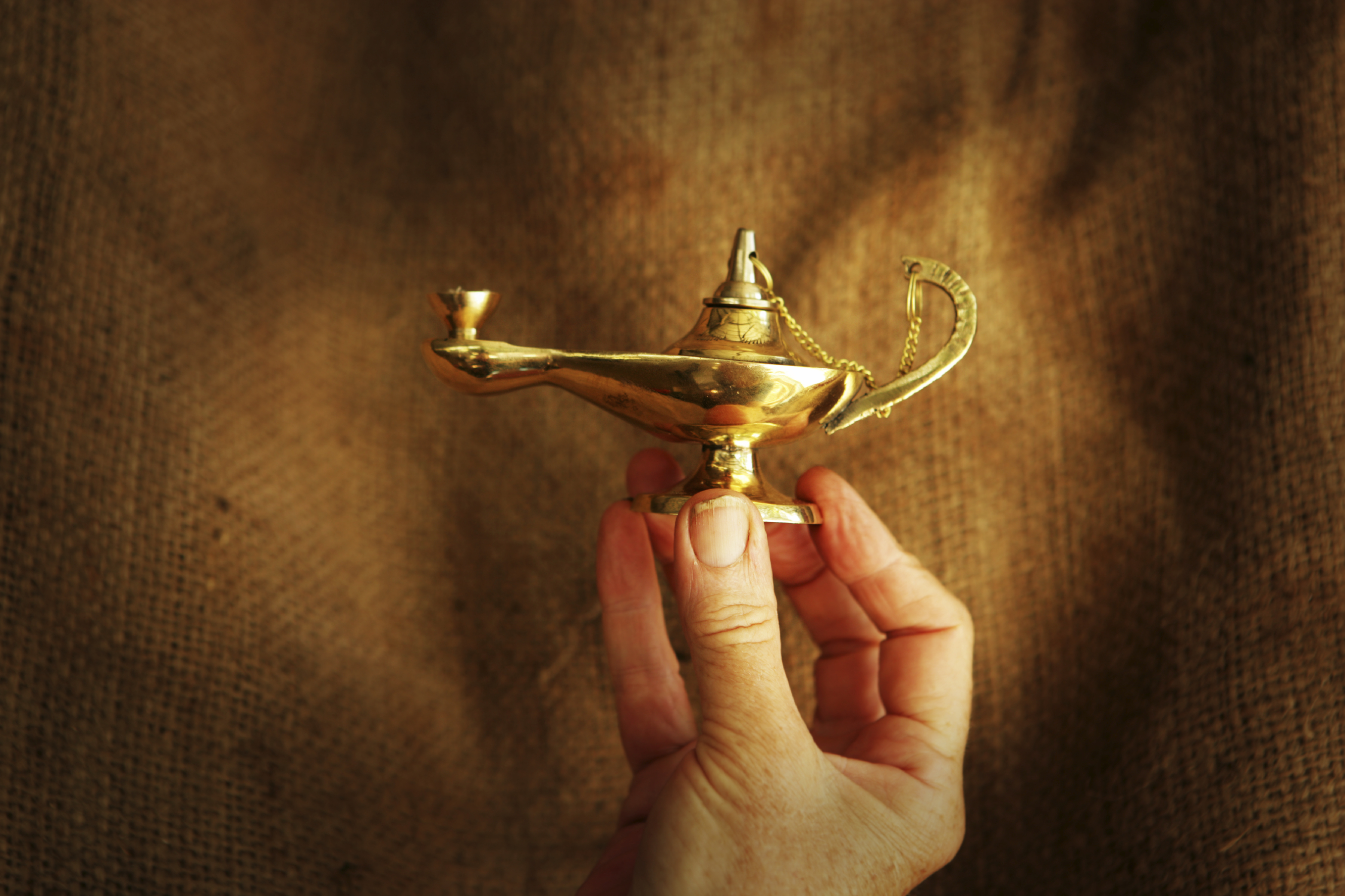 Genie lamp and hand